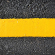New yellow line on the road texture — Stock Photo