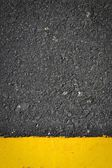 New yellow line on the road texture — Foto de Stock