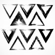 Vector set of grunge triangle brush strokes. — Stock Vector