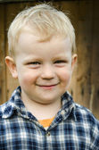 Small child  in a plaid shirt. — Stock Photo