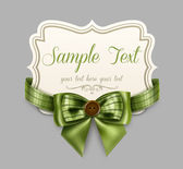 Vintage label with a green bow — Stock vektor