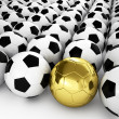 A gold football ball in many white football balls — Stock Photo