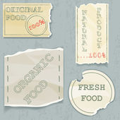 Labels of natural food on scraps of the old paper. Vector illustration — Vector de stock