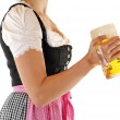 Young woman with a beer mug, dressed in a Bavarian dirndl — Stock Photo #12064438