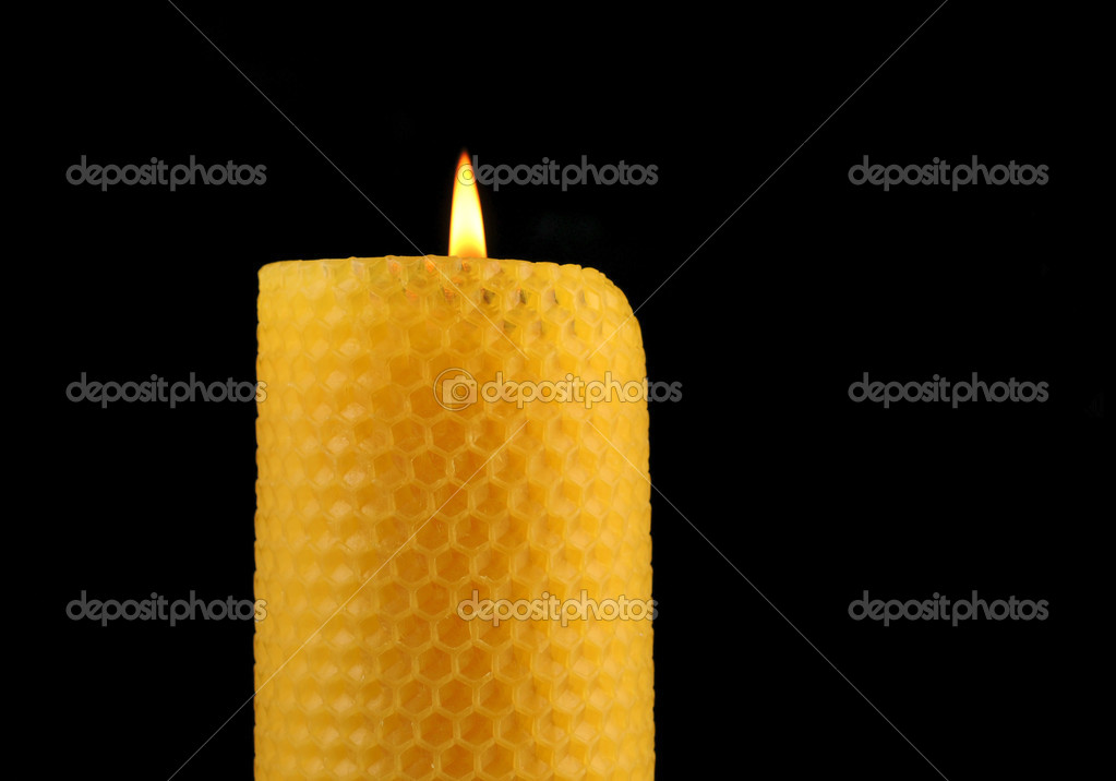 Beeswax candle in front of a black background — Stockfoto #12064441