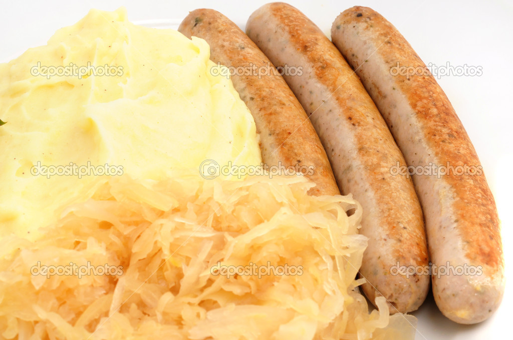 Typial bavarian meal: pork sausage, sauerkraut and mashed potatoes — Stock Photo #12189031
