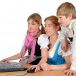 Mother with her two children and laptop — Stock Photo