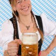 Royalty-Free Stock Photo: Woman with a Bavarian Dirndl and a beer stein