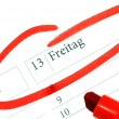 Stock Photo: Calender with marked Friday 13th