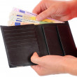 A good filled wallet in the hands — Stock Photo