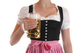 Young woman with a beer mug, dressed in a Bavarian dirndl — Zdjęcie stockowe