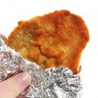 Stock Photo: Viennese Schnitzel in aluminum foil