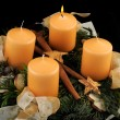 Advent wreath with yellow candles, one of them burning — Stock Photo