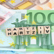 The word burnout on Euro-currency with selective focus — Stock Photo