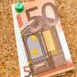 Stock Photo: Corkboard with pinned banknotes