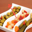 Cup with mixed pickles as appetizer — Stock Photo