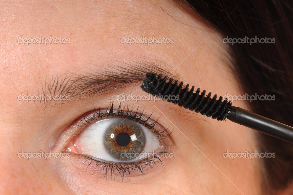 Young woman with mascara  Stock Photo #12638440