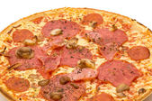 Fresh pizza with salami and ham — Stock Photo