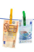 Currency on a laundry line — Stock Photo