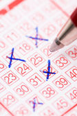 Lotto ticket with ticked numbers — Stock Photo