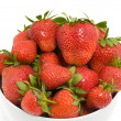 Fresh strawberries in a white bowl — Stock Photo