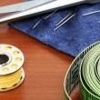 Стоковое фото: Sewing items on brown table