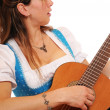 Woman with a Bavarian Dirndl and a guitar - Stock Photo