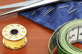 Sewing items on a brown table — Стоковое фото