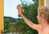 Cleaning a window — Stock Photo