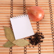 Blank notebook with spices on wooden background — Stock Photo
