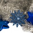 Christmas decorations blue star and snowflake — Stock Photo