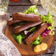 Picnic with grilled sausages - Stock Photo