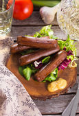 Picnic with grilled sausages — Stock Photo