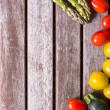Background vegetables on a wooden background — Stock Photo #25051567