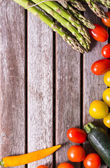 Background vegetables on a wooden background — Stock Photo