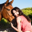 Stock Photo: Beautiful girl and a horse