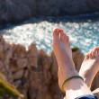 Vacation holidays. Woman feet. Relaxing enjoying sun. — Stock Photo