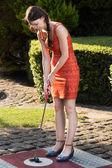 Women playing miniature golf — Stock Photo
