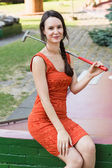 Young woman with a miniature golf club — Stock Photo