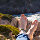 Vacation holidays. Woman feet. Relaxing enjoying sun. — Stock Photo