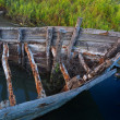 图库照片: Fishing boat wooden boat weathered skeleton