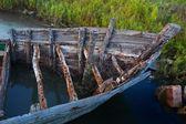 Fishing boat wooden boat weathered skeleton — Stock Photo