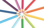Multicolored rainbow pencils in a circle, vector — Stock Vector