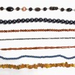 Lots of strings of beads made from natural stones — Stock Photo #13270582