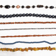Lots of strings of beads made from natural stones - Stock Photo