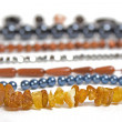 Lots of strings of beads made from natural stones — Stock Photo