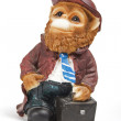 Ceramic monkey with a suitcase — Stock Photo