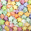 Many multicolored origami happy stars — Stock Photo