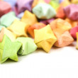 Many multicolored origami happy stars on white — Stock Photo