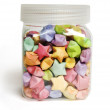 Many multicolored origami happy stars in glass pot — Stock Photo
